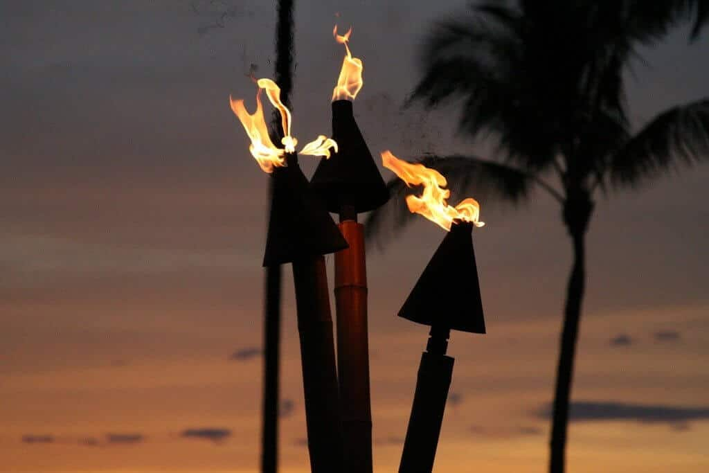 metal Tiki torches at sunset by Kevin Briody | https://www.flickr.com/photos/thekbriodys/2383535550/ via Creative Commons