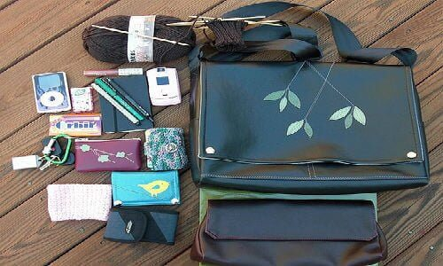 """cell phone wallet with shoulder strap """"What's in my QueenBee bag?""""   by Aine (https://www.flickr.com/photos/dainec/2911908257/in/photostream/) via Creative commons"""